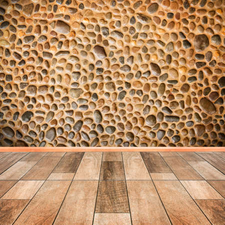 on wood floor: stone wall interior with wood floor foreground Stock Photo