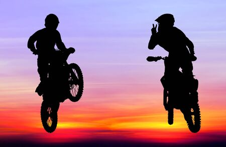 silhouette of motocross rider jump in the sky at sunset Reklamní fotografie
