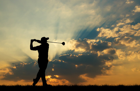 silhouette golfer playing golf during beautiful sunset Foto de archivo