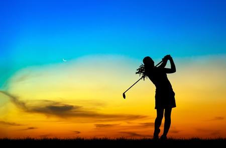 silhouette golfer playing golf during beautiful sunset Stock Photo
