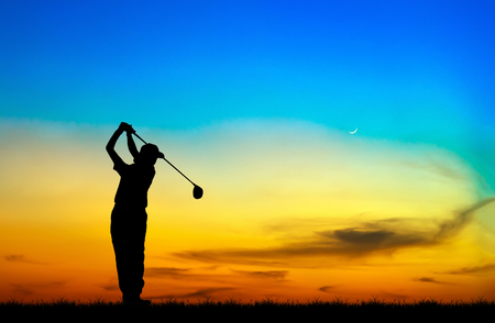 silhouette golfer playing golf during beautiful sunset Zdjęcie Seryjne