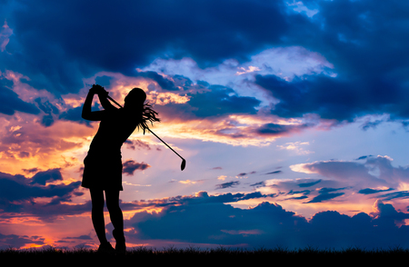 silhouette golfer playing golf during beautiful sunset 스톡 콘텐츠