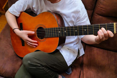 a person who plays the guitar