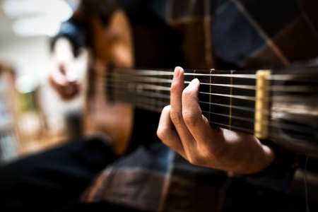 Hands of a guitar player