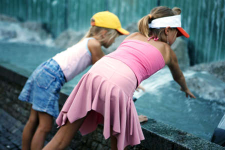 Two girls at fountain photo
