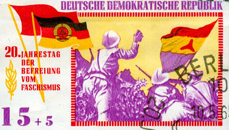 east of germany: East Germany propaganda vintage  stamp Stock Photo