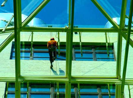 human height: Window cleaner Stock Photo