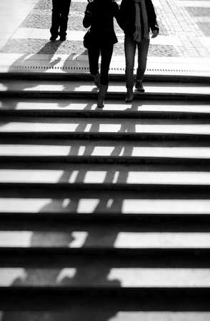 walking down: People walking down the stairs