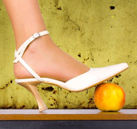 subcultures: Forbidden apple under the foot Stock Photo