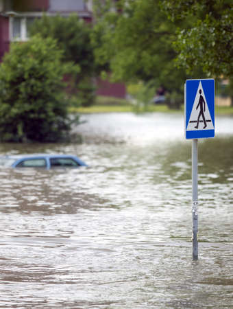 flood damage: Flooded street in the city Stock Photo