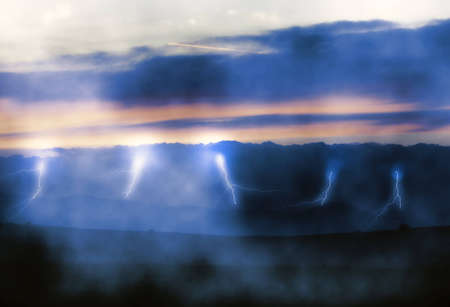 streak lightning: Lightnings over misty land