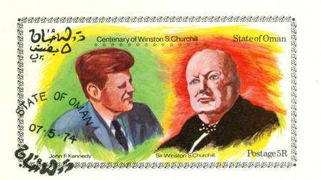 OMAN, CIRCA 1974: Stamp printed in Oman of Centenary of  Winston Churchill with John F. Kennedy, circa 1974 photo