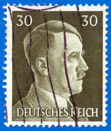 adolf: GERMANY - CIRCA 1942: An GERMANY Used Postage Stamp showing Portrait of Adolf Hitler, circa 1942.