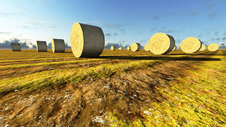 Straw bales on field against sky photo