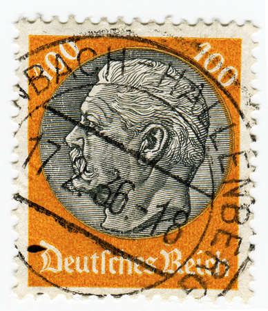 hindenburg: GERMANY - CIRCA 1933: A 100pf stamp printed in Germany  of President Hindenburg in new value, circa 1933 Stock Photo