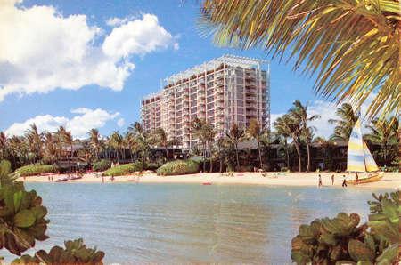 Hawaii USA - CIRCA 1978: Postcard showing Honolulu beach with tourist and hotels, circa 1978