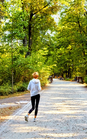 Anorexic young woman jogging in the park
