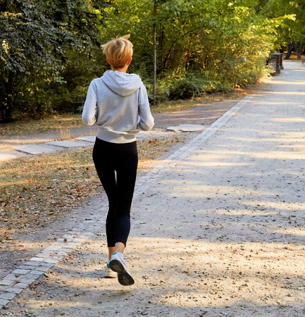 Anorexic young woman jogging in the park Imagens - 55454431