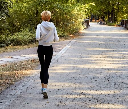 Anorexic young woman jogging in the park Imagens - 55454432