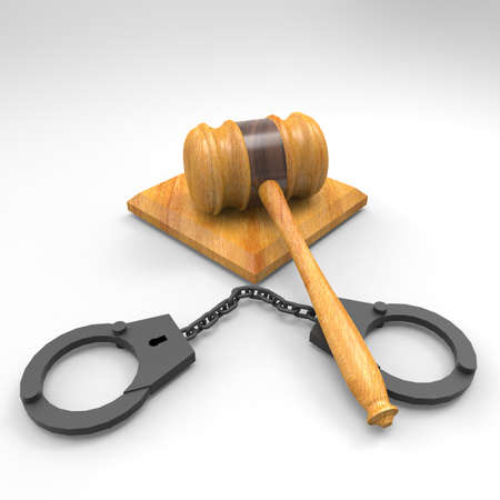 handcuffs and gavel isolated on white backdrop