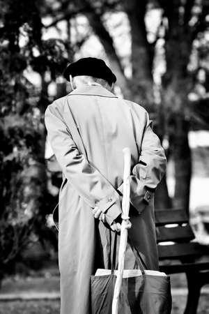 公園を歩いていたら高齢者シニア 写真素材