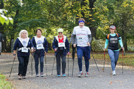WROCLAW, POLAND - OCTOBER 15, 2017: People in fitness course nordic walking competition in the city park