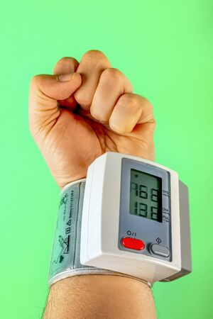 Wrist blood pressure gauge show hypertension Reklamní fotografie - 134457484