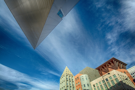 Triangular and other unusual shapes outline an ultra-modern urban skyline   Featuring the Denver Art Museum and downtown public library  新聞圖片