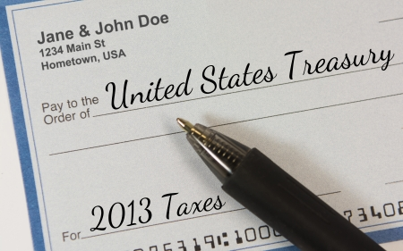 payable: A personal check with pen, made payable to the United States Treasury for 2013 Taxes