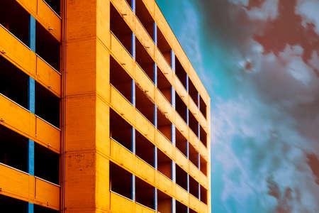 Work in progress yellow building with super sky Imagens