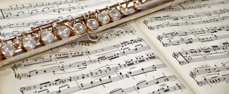 Musical notes and flute Stock Photo