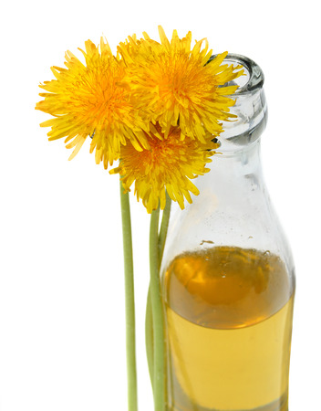 nature cure: Dandelion Wine in a glass bottle