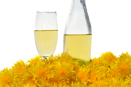 nature cure: Dandelion Wine in glass and bottle