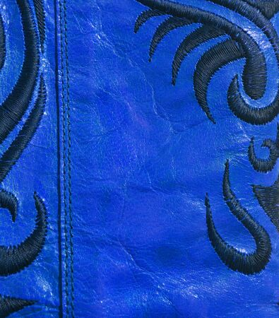genuine: Genuine leather blue floral background Stock Photo