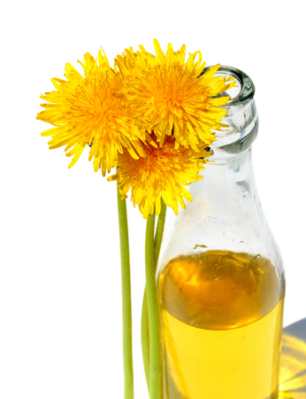 nature cure: Dandelion wine in a glass bottle Stock Photo