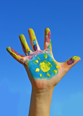 kids painted hands: Painted kid hand with sun