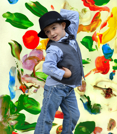 exhilaration: Child dancing on a painted background