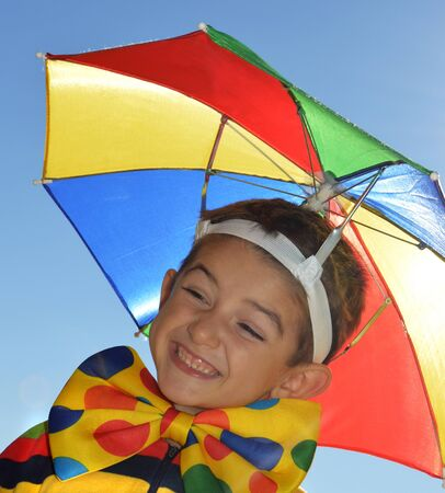 sunshade: Happy child with colorful sunshade and bow tie