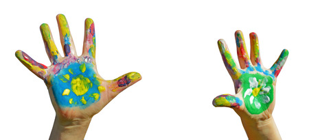kids painted hands: Painted kid hands on a white background Stock Photo