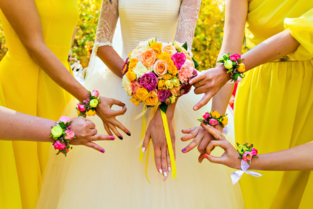 purple dress: bridesmaids and bride and a  bridal bouquet