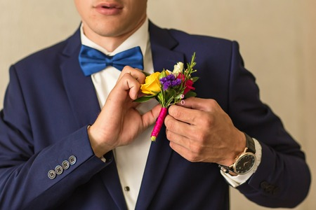 boutonniere: grooms boutonniere of roses and different flowers