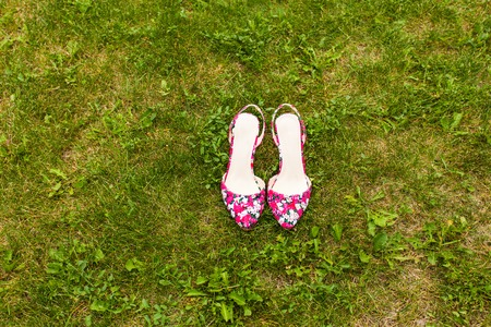 pink shoes: beautiful pink shoes on the green grass