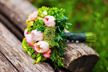 hand holding flower: wedding bouquet, bridal bouquet, beautiful bouquet of different colors Stock Photo