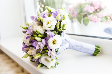 outdoor wedding: wedding bouquet, bridal bouquet, beautiful bouquet of different colors Stock Photo