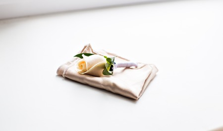 Beautifull white rose boutonniere flower. wedding boutonniere 写真素材