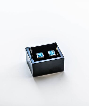 cufflinks: blue cufflinks, mens accessories, a stylish blue cufflinks Stock Photo