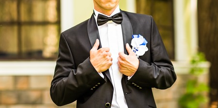 Close-up shot of a man dressed in formal wear .Grooms suit