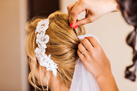 Hair stylist makes the bride before the wedding Stock Photo