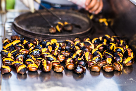 opened bag: Delicious roasted chestnuts.  Street food in Istanbul