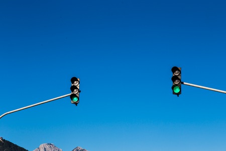 sun light: two traffic lights on the main road